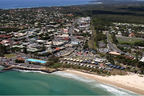 Photo of Byron Bay township including beach and bypass route behind main street