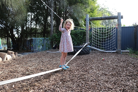 Photo-of-child-on-balancing-ropes-at-childcare-centre