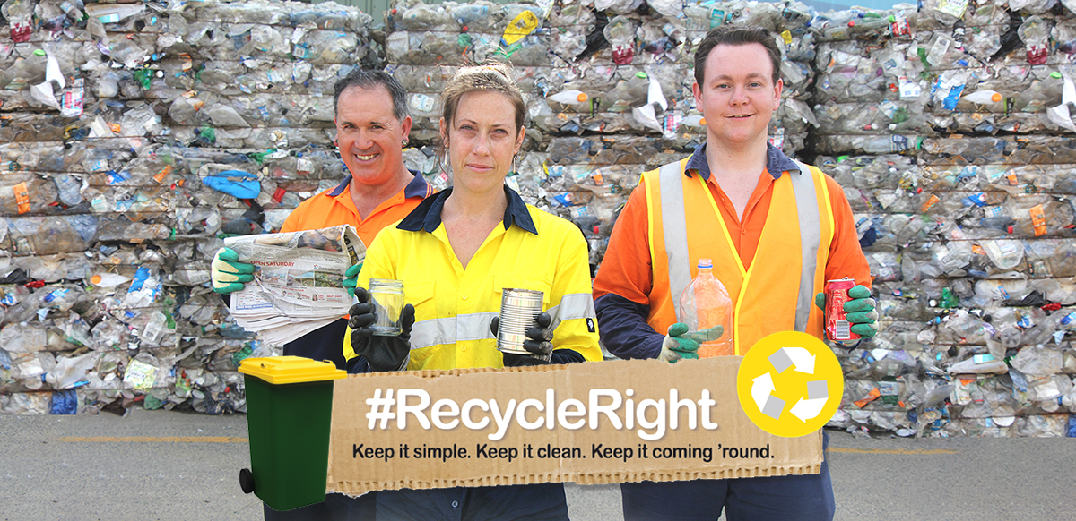 People holding recyclable materials for the recycle right campaign